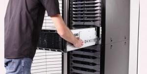 a man sliding in a computer server rack