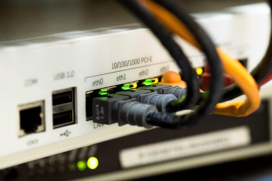 ethernet cables plugged into a reseller hosting computer