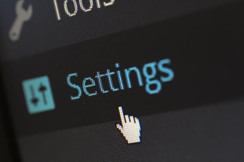 A computer cursor hovering over the settings button of a website reseller hosting menu