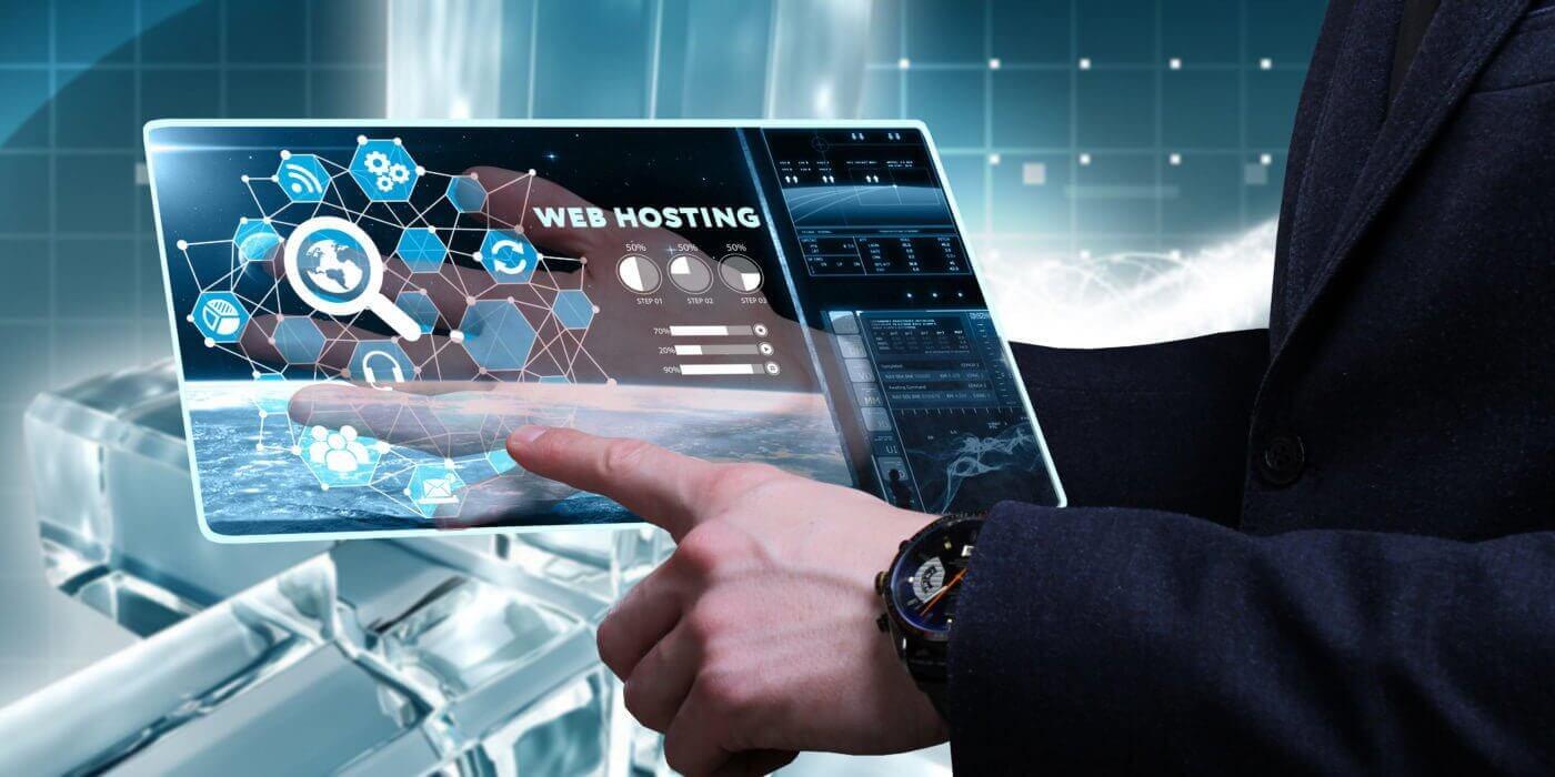 man holding tablet showing web hosting information