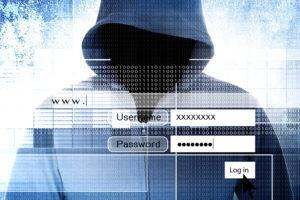 A person in a hoody performing a cyber attack