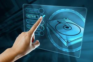 a woman finger choice a option to repair a hard disk on a digital screen